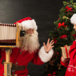 Photo of Santa Claus with his wife taking pictures — Stock Photo