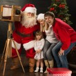 Santa Claus taking picture of full family with old wooden camera — Stock Photo