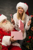 Photo of Santa Claus with his wife — Стоковое фото
