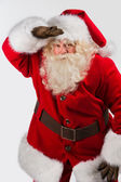 Santa Claus standing isolated on white background — Stock Photo