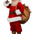 Real Santa Claus carrying big bag full of gifts — Stock Photo #36520047
