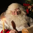 Santa Claus sitting at home and writing a letter — Stock Photo #36520107