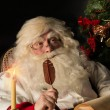 Santa Claus sitting at home and writing a letter — Stock Photo #36520121
