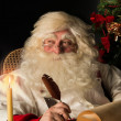 Santa Claus sitting at home and writing a letter — Stock Photo
