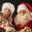 Santa Claus sitting at home with family   — Stock Photo
