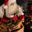 Santa Claus opening his sack and taking gifts — Stock Photo #36520463