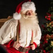 Real Santa Claus carrying big bag full of gifts — Stock Photo #36520465