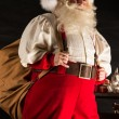 Real Santa Claus carrying big bag full of gifts — Stock Photo #36520479