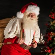 Real Santa Claus carrying big bag full of gifts — Stock Photo #36520499