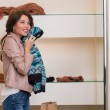 Beautiful Woman with Sweater in Clothes Store — Stock Photo