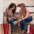 Two young attractive girlfriends go shopping — Stock Photo