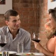 Young happy couple on romantic date — Stock Photo