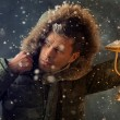 Brutal mwalking under snowstorm at night lighting his way with lantern — Stock Photo #36952171