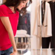 Happy young woman shopping in boutique store — Stock Photo