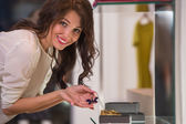 Young woman looking at the shop showcase — Stock Photo