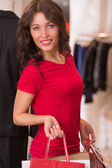 Beautiful Woman with Shopping Bags in Shopping Mall — Stock Photo