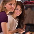 Two beautiful young girls choosing accessories at store — Stock Photo #37353553
