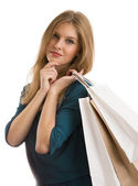 Portrait of young happy smiling woman with shopping bags — Stock Photo