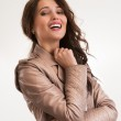Beautiful brunette woman laughing and looking at camera — Stock Photo #38642677