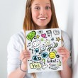 Stock Photo: Young girl student holding sign with online services symbols