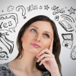 Stock Photo: Young pretty womthinking of her plans closeup face portrait