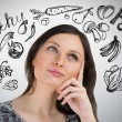 Young pretty woman thinking of healthy food closeup face portrait — Stock Photo #38643497