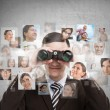 Stock Photo: Business mlooking for employees through binoculars.