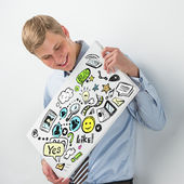 Business man holding a sign with online services symbols — Stock Photo