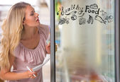 Young pretty woman thinking of healthy food while shopping at grocery store — Stock Photo