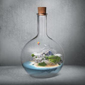 Corked glass bottle with beautiful island and sea inside. — Stock Photo
