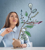 Concept of Growing company with sketch of a plant with business symbols — Stock Photo