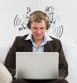 Young business man listening to music and working in his wake — Stock Photo
