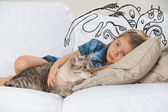 Scared little girl hugging her cat. Sketches of his fictional fears around her — Stock Photo