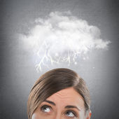 Close up of young woman looking up for thought bubble above her head with copy space — Stock Photo