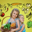 Two girls with basket of food — Stock Photo