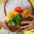 Woman with basket of food — Stock Photo