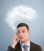 Businessman and cloud of thoughts — Stock Photo