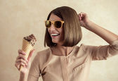 Ice cream woman singing in cone like in microphone — Stock Photo