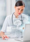Doctor scanning brain of patient — Stock Photo