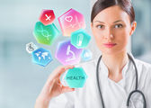 Doctor working with healthcare icons — Stock Photo