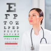 Oculist in front of eyesight test — Stock Photo
