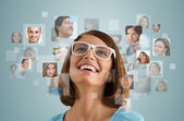 Woman with different people's faces — Stock Photo