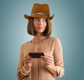 Woman in hat with smartphone — Stock Photo