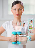 Woman doing exercise with dumbbells — Stock Photo