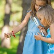 Stock Photo: Children with magnifying glass