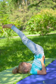 Little girl stretching at park  — Stockfoto