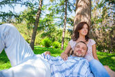 Adult couple picnicking in the summer park under the tree — Stock Photo