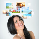 Woman with travel vacation memories — Stockfoto