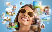Portrait of young happy woman sharing her travel vacation photo  — Stock Photo