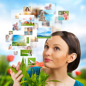 Woman sharing her photo and video files — Stock Photo